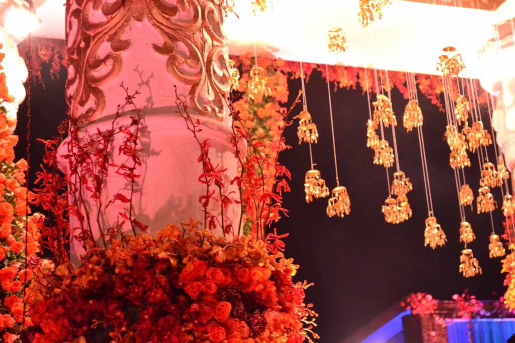 Indian Wedding Photos | This is from the Pandal - see the hanging figures?