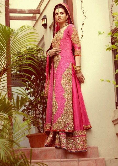 A beautiful pink bridal lehenga with gold embroidery by Nomi Ansari