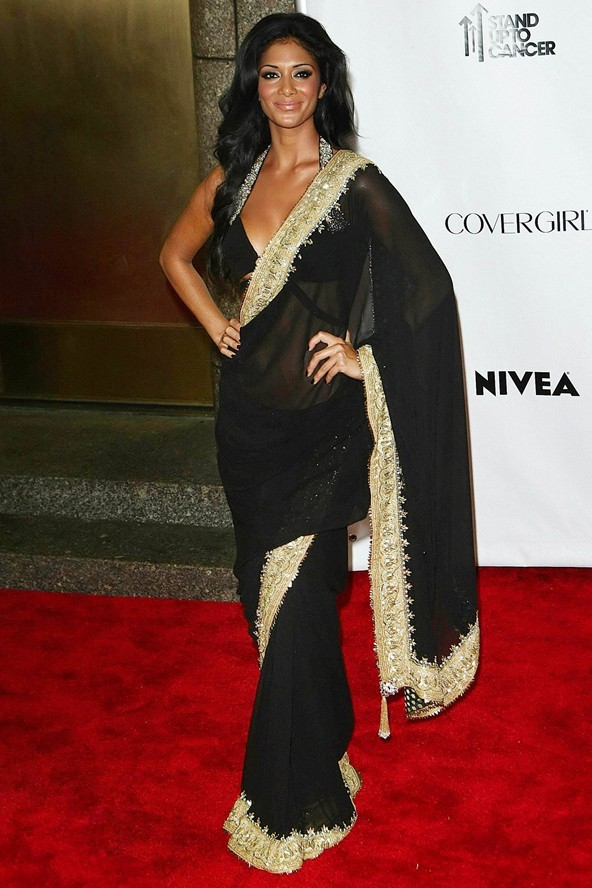 Nicole Scherzinger in a black and gold saree - Bollywood Sarees